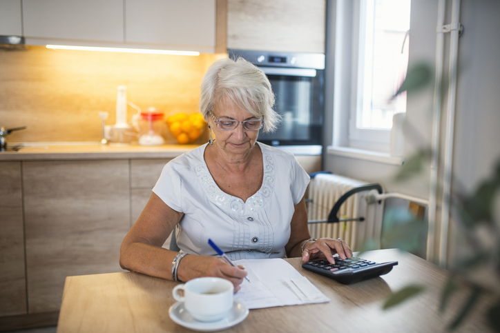 Senior woman signing a Henson trust